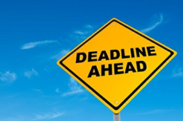 "Photo of a roadside sign with the text ""Deadline ahead""."
